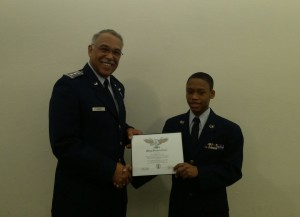Maj Gen Carr presents Cadet Arshad White the Wright brothers award